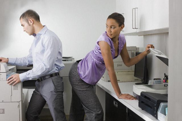 Businesswoman Attracted to Businessman --- Image by © Sean De Burca/Corbis